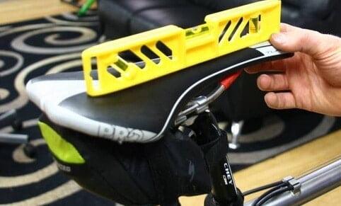 Exercise bike seat slant angle for comfort