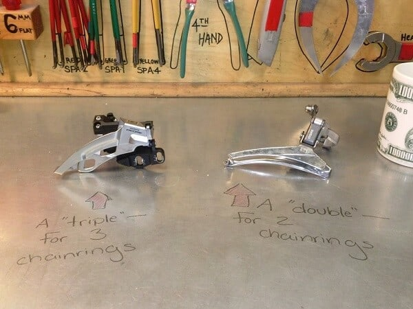 Double and triple cage derailleurs